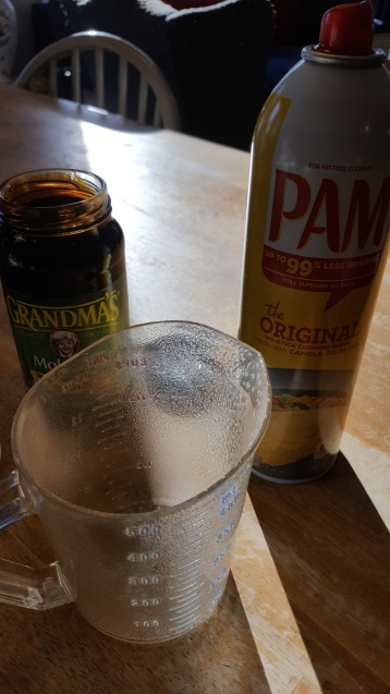 Spray your measuring cup with Pam before measuring molasses