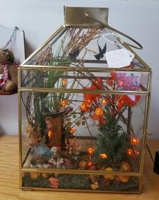 A fairy garden under glass